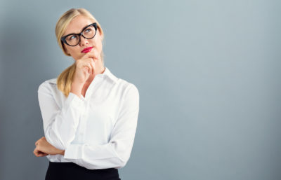 birth control methods | bespectacled woman thinking | CU Rocky Mountain OB-GYN