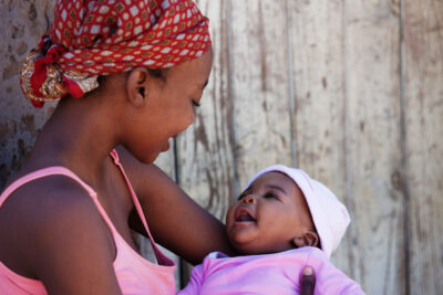 meaningful change for women's health around the world | African mother with baby girl | CU Rocky Mountain OB-GYN