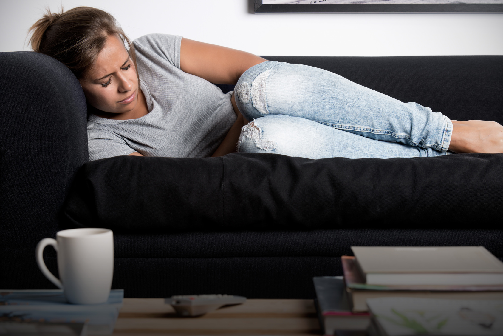 fibroids | CU Rocky Mountain OB-GYN | woman in pain on couch